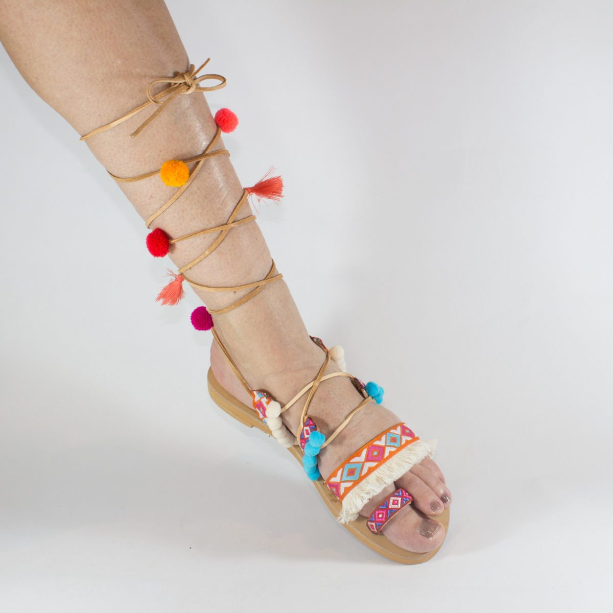 Lace up pom pom sandals